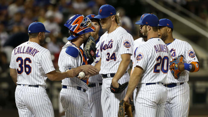 NEW YORK, NEW YORK - JUNE 30:   Noah Syndergaard #34 of the New York Mets hands the ball to manager Mickey Callaway #36 as he is removed from a game against the Atlanta Braves during the sixth inning at Citi Field on June 30, 2019 in New York City. (Photo by Jim McIsaac/Getty Images)