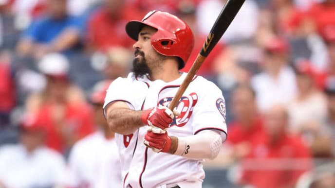 WASHINGTON, DC - SEPTEMBER 14: Anthony Rendon #6 of the Washington Nationals doubles in Trea Turner #7 (not pictured) in the first inning during a baseball game against the Atlanta Braves at Nationals Park on September 14, 2019 in Washington, DC.  (Photo by Mitchell Layton/Getty Images)