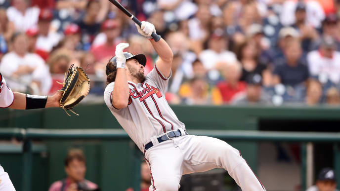 WASHINGTON, DC - SEPTEMBER 14:  Charlie Culberson #8 of the Atlanta Braves reacts after getting hit by a ball in the seventh inning during a baseball game against the Washington Nationals at Nationals Park on September 14, 2019 in Washington, DC.  (Photo by Mitchell Layton/Getty Images)