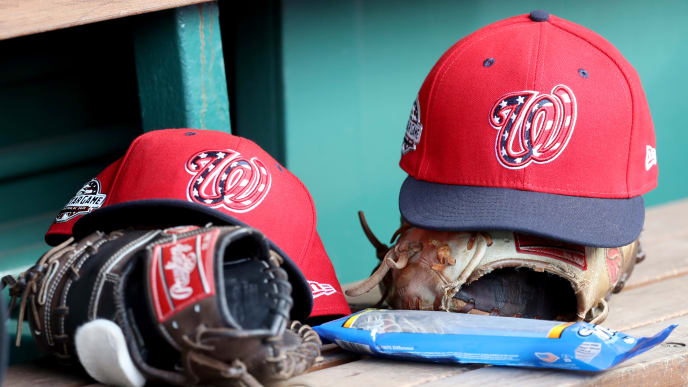 WASHINGTON, DC - JULY 22: Washington Nationals gloves and hats sit in the dugout during the Nationals and Atlanta Braves game at Nationals Park on July 22, 2018 in Washington, DC. (Photo by Rob Carr/Getty Images)