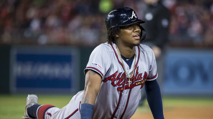 WASHINGTON, DC - SEPTEMBER 13: Ronald Acuna Jr. #13 of the Atlanta Braves looks up from first base against the Washington Nationals during the fifth inning at Nationals Park on September 13, 2019 in Washington, DC. (Photo by Scott Taetsch/Getty Images)