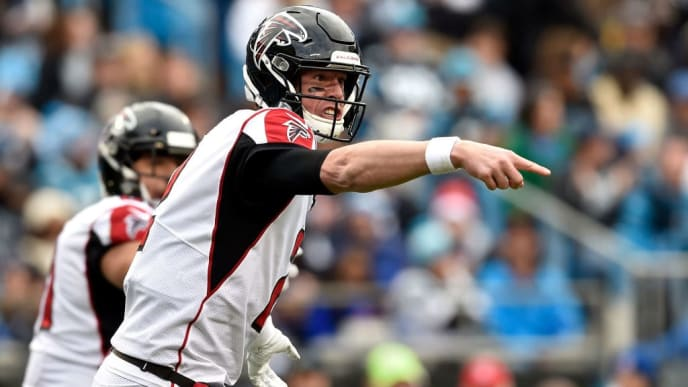 CHARLOTTE, NORTH CAROLINA - DECEMBER 23: Matt Ryan #2 of the Atlanta Falcons makes a call at the line against the Carolina Panthers in the second quarter during their game at Bank of America Stadium on December 23, 2018 in Charlotte, North Carolina. (Photo by Grant Halverson/Getty Images)