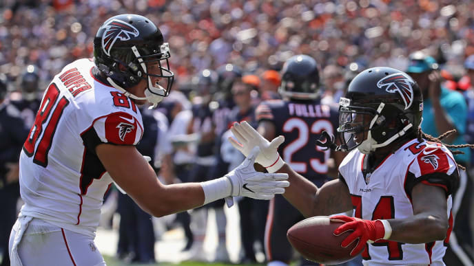CHICAGO, IL - SEPTEMBER 10:   Devonta Freeman #24 of the Atlanta Falcons (R) is congratulated by  Austin Hooper #81 after running for a touchdown against the Chicago Bears during the season opening game at Soldier Field on September 10, 2017 in Chicago, Illinois. The Falcons defeated the Bears 23-17. (Photo by Jonathan Daniel/Getty Images)