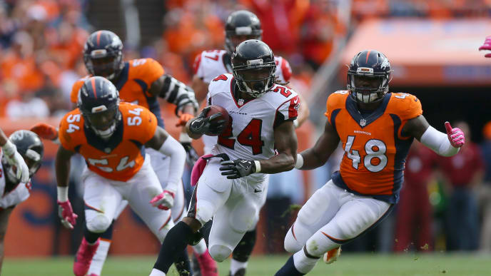 DENVER, CO - OCTOBER 9:  Running back Devonta Freeman #24 of the Atlanta Falcons runs with the ball in the game against the Denver Broncos at Sports Authority Field at Mile High on October 9, 2016 in Denver, Colorado. (Photo by Justin Edmonds/Getty Images)