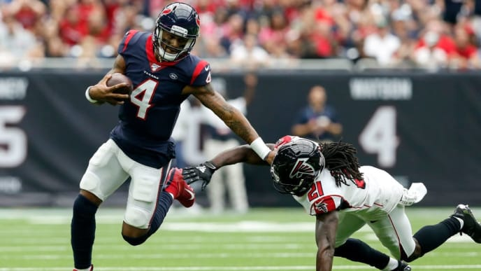HOUSTON, TX - OCTOBER 06:  Deshaun Watson #4 of the Houston Texans scrambles under pressure by Desmond Trufant #21 of the Atlanta Falcons in the first half at NRG Stadium on October 6, 2019 in Houston, Texas.  (Photo by Tim Warner/Getty Images)