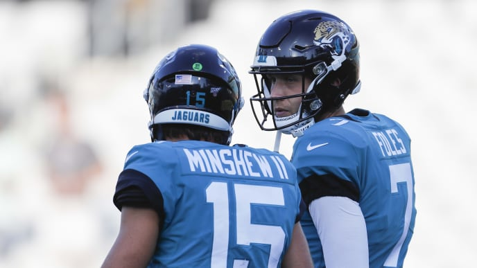 JACKSONVILLE, FLORIDA - AUGUST 29: Nick Foles #7 of the Jacksonville Jaguars talks with Gardner Minshew #15 before the start of a preseason game at TIAA Bank Field against the Atlanta Falcons on August 29, 2019 in Jacksonville, Florida. (Photo by James Gilbert/Getty Images)