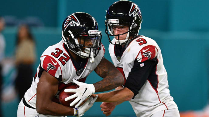 MIAMI, FL - AUGUST 08: Matt Simms #9 of the Atlanta Falcons hands the ball to Qadree Ollison #32 in the  fourth quarter during a preseason game against the Miami Dolphins at Hard Rock Stadium on August 8, 2019 in Miami, Florida. (Photo by Mark Brown/Getty Images)