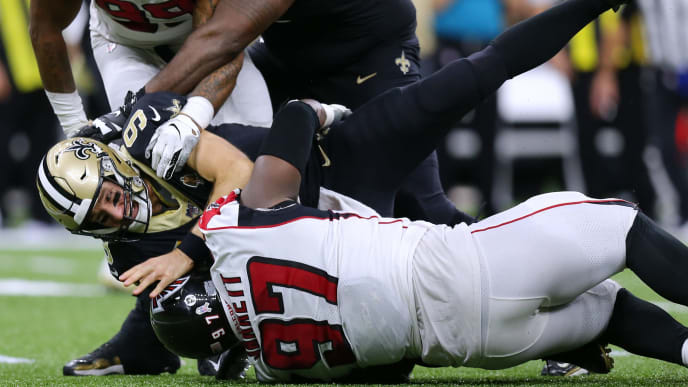NEW ORLEANS, LOUISIANA - NOVEMBER 10: Drew Brees #9 of the New Orleans Saints is sacked by Grady Jarrett #97 of the Atlanta Falcons and Adrian Clayborn #99 during the second half of a game at the Mercedes Benz Superdome on November 10, 2019 in New Orleans, Louisiana. (Photo by Jonathan Bachman/Getty Images)