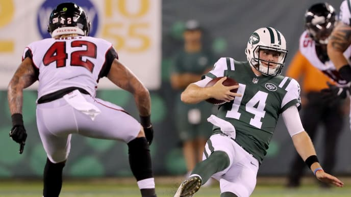 EAST RUTHERFORD, NJ - AUGUST 10:  Sam Darnold #14 of the New York Jets carries the ball as Duke Riley #42 of the Atlanta Falcons defends during a preseason game at MetLife Stadium on August 10, 2018 in East Rutherford, New Jersey.  (Photo by Elsa/Getty Images)
