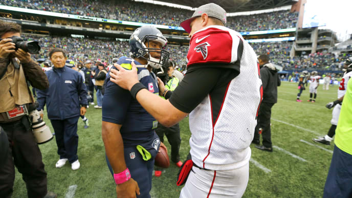 SEATTLE, WA - OCTOBER 16:  Quarterback Russell Wilson #3 of the Seattle Seahawks greets Atlanta Falcons quarterback Matt Ryan #2 at the end of the game at CenturyLink Field on October 16, 2016 in Seattle, Washington.  (Photo by Jonathan Ferrey/Getty Images)