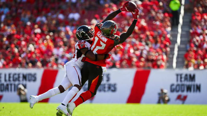 TAMPA, FL - DECEMBER 30: Wide receiver Chris Godwin #12 of the Tampa Bay Buccaneers is wrapped up by cornerback Robert Alford #23 of the Atlanta Falcons as he stretches for a pass from quarterback Jameis Winston #3 of the game at Raymond James Stadium on December 30, 2018 in Tampa, Florida. (Photo by Will Vragovic/Getty Images)