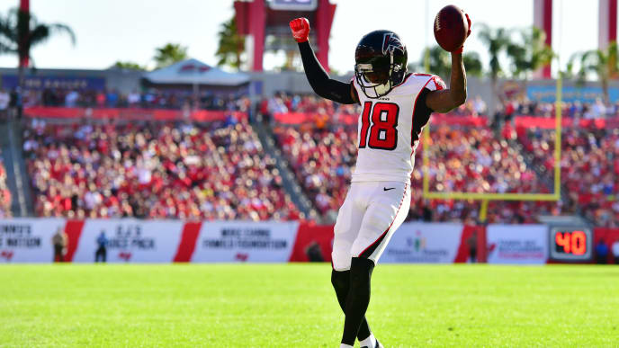 TAMPA, FLORIDA - DECEMBER 30: Calvin Ridley #18 of the Atlanta Falcons celebrates as he runs into the endzone to score during the fourth quarter against the Tampa Bay Buccaneers at Raymond James Stadium on December 30, 2018 in Tampa, Florida. The Falcons won 34-32. (Photo by Julio Aguilar/Getty Images)