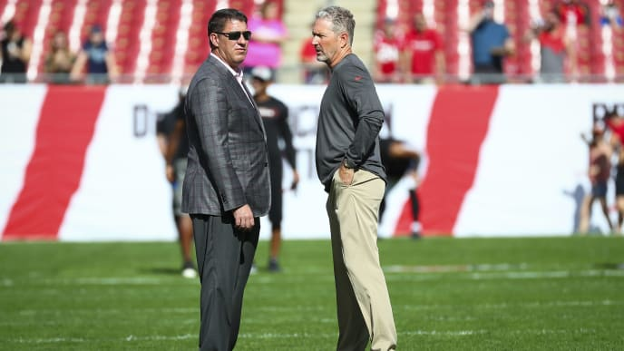 TAMPA, FL - DECEMBER 30: General manager Jason Licht of the Tampa Bay Buccaneers talks with head coach Dirk Koetter before the game against the Atlanta Falcons at Raymond James Stadium on December 30, 2018 in Tampa, Florida. (Photo by Will Vragovic/Getty Images)