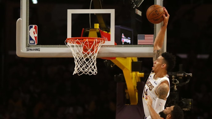 LOS ANGELES, CALIFORNIA - NOVEMBER 17:  Danny Green #14 of the Los Angeles Lakers dunks the ball as Allen Crabbe #33 of the Atlanta Hawks defends during the first half of a game at Staples Center on November 17, 2019 in Los Angeles, California. NOTE TO USER: User expressly acknowledges and agrees that, by downloading and or using this photograph, User is consenting to the terms and conditions of the Getty Images License Agreement.  (Photo by Katharine Lotze/Getty Images)