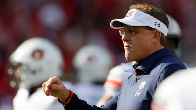 TUSCALOOSA, AL - NOVEMBER 24:  Head coach Gus Malzahn of the Auburn Tigers runs through warmups prior to facing the Alabama Crimson Tide at Bryant-Denny Stadium on November 24, 2018 in Tuscaloosa, Alabama.  (Photo by Kevin C. Cox/Getty Images)