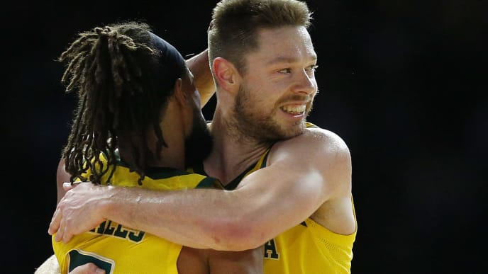 MELBOURNE, AUSTRALIA - AUGUST 24: Patty Mills of the Boomers (L) celebrates with Matthew Dellavedova of the Boomers during game two of the International Basketball series between the Australian Boomers and United States of America at Marvel Stadium on August 24, 2019 in Melbourne, Australia. (Photo by Daniel Pockett/Getty Images)