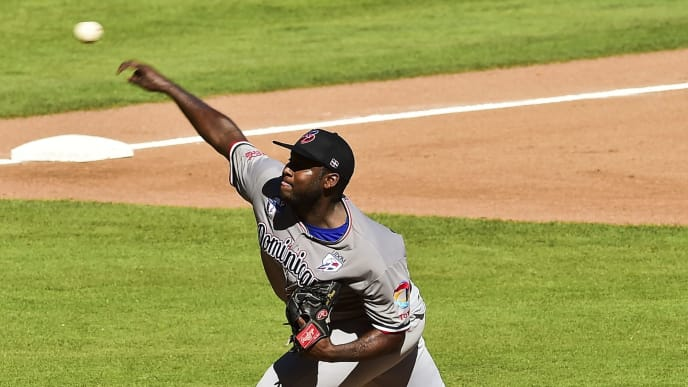 Pitcher Ariel Pena of Tigres del Licey from Dominican Republic throws against Aguilas del Zulia of Venezuela during the Caribbean Baseball Series at the Tomateros stadium in Culiacan, Sinaloa State, Mexico, on February 5, 2017. / AFP / RONALDO SCHEMIDT        (Photo credit should read RONALDO SCHEMIDT/AFP via Getty Images)