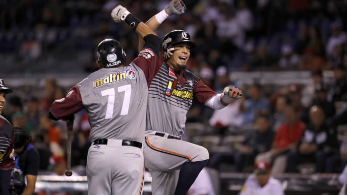 Rafael Ortega Caribes de Anzoategui of Venezuela celebrates after scoring against Tomateros de Culiacan of Mexico during the Caribbean Baseball Series at the Charros Jalisco stadium in Guadalajara, Jalisco state, Mexico, on February 4, 2018. / AFP PHOTO / ULISES RUIZ        (Photo credit should read ULISES RUIZ/AFP via Getty Images)