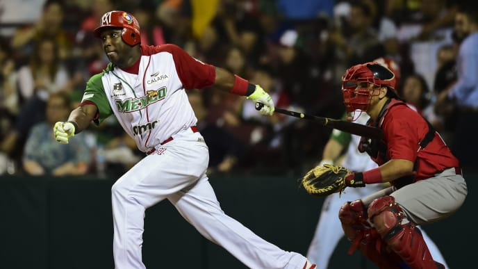 Yuniesky Betancourt of Aguilas de Mexicali from Mexico bats against Criollos de Caguas from Puerto Rico during the final of Caribbean Baseball Series, at the Tomateros stadium, in Culiacan, Sinaloa State, Mexico, on February 7, 2017. / AFP / RONALDO SCHEMIDT        (Photo credit should read RONALDO SCHEMIDT/AFP via Getty Images)