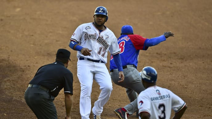 Michael Dimock (C) of Tigres de Licey of the Dominican Republic slides safe into first base in a match against Alazanes de Granma of Cuba during the Caribbean Baseball Series at the Tomateros stadium in Culiacan, Sinaloa State, Mexico on February 1, 2017. / AFP / RONALDO SCHEMIDT        (Photo credit should read RONALDO SCHEMIDT/AFP/Getty Images)