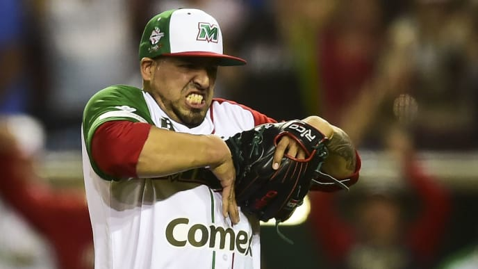 Pitcher Jake Sanchez of Aguilas de Mexicali from Mexico celebrates victory over Alazanes de Granma from Cuba in the semifinals of Caribbean Baseball Series at the Tomateros stadium, in Culiacan, Sinaloa State, Mexico, on February 6, 2017. / AFP / RONALDO SCHEMIDT        (Photo credit should read RONALDO SCHEMIDT/AFP via Getty Images)