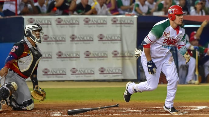 Gabriel Gutierrez (R) of Mexico's Charros de Jalisco runs after hit of Home Run against Venezuela's Cardenales de Lara during the Caribbean Series baseball tournament at Rod Carew stadium in Panama City on February 8, 2019. (Photo by Luis ACOSTA / AFP)        (Photo credit should read LUIS ACOSTA/AFP/Getty Images)