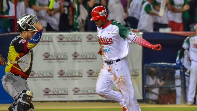 Alonzo Harris (R) of Mexico's Charros de Jalisco scores a run against Juan Apodaca of Venezuela's Cardenales de Lara during the Caribbean Series baseball tournament at Rod Carew stadium in Panama City on February 8, 2019. (Photo by Luis ACOSTA / AFP)        (Photo credit should read LUIS ACOSTA/AFP/Getty Images)