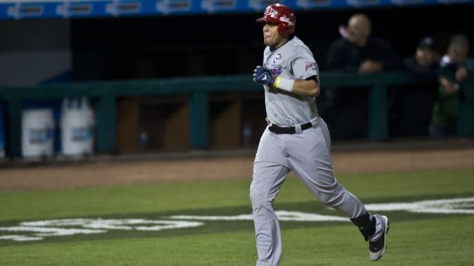 Francisco Peña of Leones del Escogido of Dominican Republic, runs after his home run against Magallanes of Venezuela, during the 2013 Caribbean baseball series, on February 6, 2013, in Hermosillo, Sonora State, in the northern of Mexico. AFP PHOTO/Ronaldo Schemidt        (Photo credit should read Ronaldo Schemidt/AFP via Getty Images)