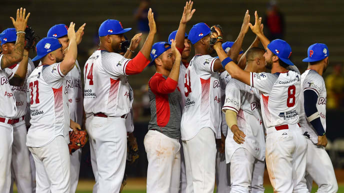 Panama´s Toros de Herrera players celebrate their victory against Puerto Rico´s Cangrejeros de Santurce during the Caribbean Series baseball tournament at the Rod Carew stadium in Panama City, Panama, on February 9, 2019. (Photo by Luis ACOSTA / AFP)        (Photo credit should read LUIS ACOSTA/AFP/Getty Images)