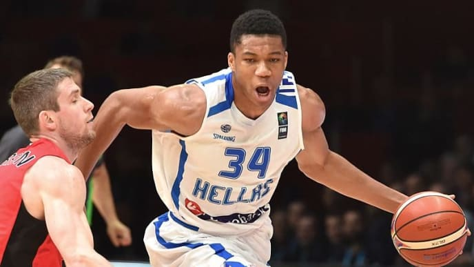 Greece's small forward Giannis Antetokounmpo works around Belgium's shooting guard Quentin Serron during the round of 16 basketball match between Greece and Belgium at the EuroBasket 2015 in Lille, northern France, on September 12, 2015.  AFP PHOTO / PHILIPPE HUGUEN        (Photo credit should read PHILIPPE HUGUEN/AFP/Getty Images)