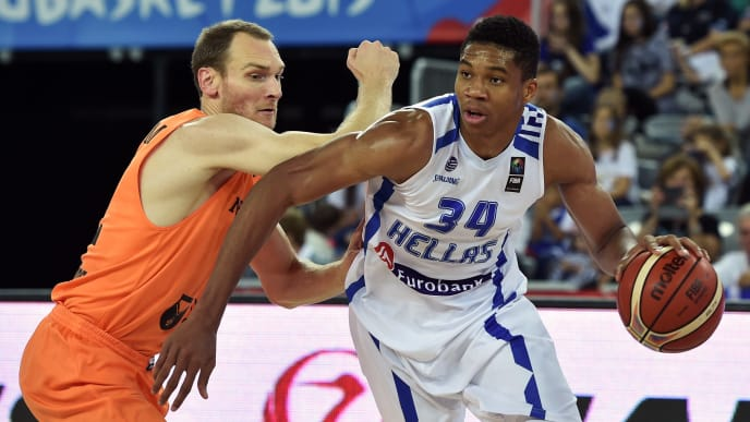 Greece's forward Giannis Antetokounmpo (R) vies with Netherlands' forward Kees Akerboom during the Group C qualification basketball match between Greece and Netherlands at the EuroBasket 2015 in Zagreb on September 10, 2015.  AFP PHOTO / ANDREJ ISAKOVIC        (Photo credit should read ANDREJ ISAKOVIC/AFP/Getty Images)