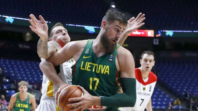 Germany's Daniel Theis vies against Lithuania's Jonas Valanciunas (R) during the FIBA EuroBasket 2017 championship match between Germany and Lithuania at Menora Mivtachim Arena in Tel Aviv on September 6, 2017. / AFP PHOTO / JACK GUEZ        (Photo credit should read JACK GUEZ/AFP/Getty Images)
