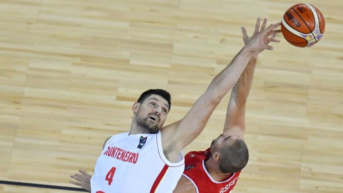 Janos Eilingsfeld (R) of Hungary vies with Nikola Vucevic (L) of Montenegro during the Group C of the FIBA Eurobasket 2017 mens basketball match between Hungary and Montenegro in Cluj Napoca city September 2, 2017.  / AFP PHOTO / DANIEL MIHAILESCU        (Photo credit should read DANIEL MIHAILESCU/AFP/Getty Images)