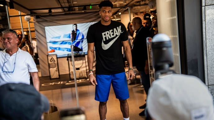 """Milwaukee Bucks forward and NBA's Most Valuable Player for the 2018-2019 season Giannis Antetokounmpo poses for pictures in front of a Nike store after attending a promotional event, at the Syntagma square in Athens on June 28, 2019. - Speaking at an event in Athens to promote his line of sports shoes, """"Greek Freak"""" Giannis Antetokounmpo said on June 28, 2019 that he would play for Greece at the FIBA Basketball World Cup in China this summer. (Photo by ANGELOS TZORTZINIS / AFP)        (Photo credit should read ANGELOS TZORTZINIS/AFP/Getty Images)"""