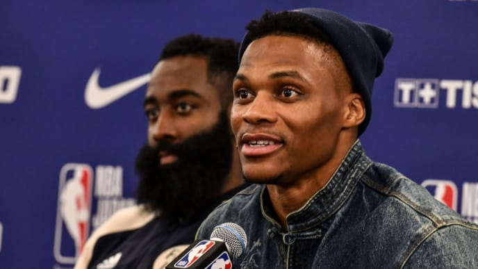 Houston's guard Russel Westbrook (R) answers questions beside James Harden (L) during a press conference after the NBA Japan Games 2019 pre-season basketball match between Houston Rockets and Toronto Raptors in Saitama, northern suburb of Tokyo on October 10, 2019. (Photo by TOSHIFUMI KITAMURA / AFP) (Photo by TOSHIFUMI KITAMURA/AFP via Getty Images)