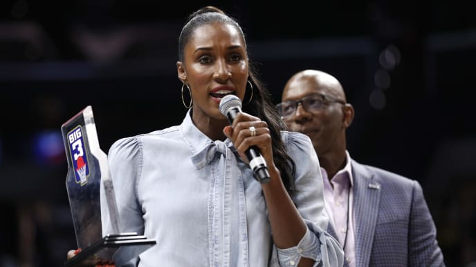 LOS ANGELES, CALIFORNIA - SEPTEMBER 01: Head coach Lisa Leslie of the Triplets is awarded the Coach of the Year trophy by BIG3 commissioner Clyde Drexler (R) during the BIG3 Championship at Staples Center on September 01, 2019 in Los Angeles, California. (Photo by Meg Oliphant/BIG3 via Getty Images)