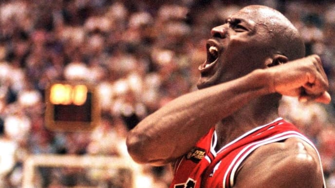 (FILES) In this 14 June 1998 file photo, Michael Jordan of the Chicago Bulls celebrates after winning game six of the NBA Finals against the Utah Jazz at the Delta Center in Salt Lake City, UT. The win gave the Bulls their sixth NBA championship. It was reported by Fox Sports 31 March 1999 that Jordan, who announced his retirement 13 January 1999, is contemplating playing next season for the Charlotte Hornets, the National Basketball Association club in which Jordan is considering purchasing a 50 percent share. AFP PHOTO/FILES/Robert SULLIVAN (Photo by ROBERT SULLIVAN / AFP)        (Photo credit should read ROBERT SULLIVAN/AFP/Getty Images)