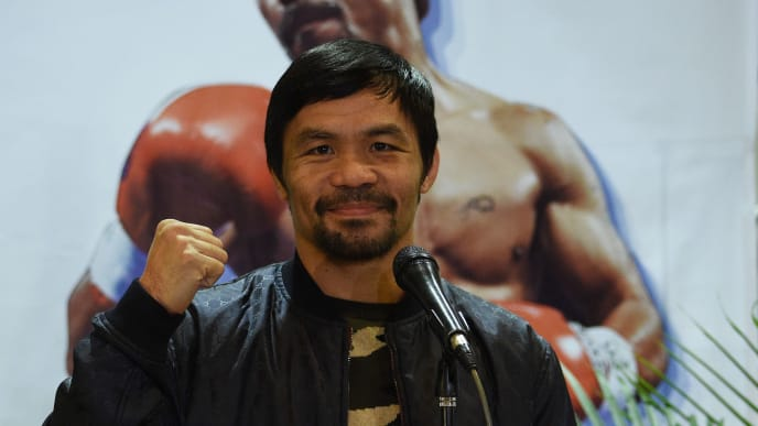 Philippine boxing icon Manny Pacquiao poses for photos during a press conference shortly after arriving at the international airport in Manila on January 24, 2019, days after defeating US boxer Adrien Broner in Las Vegas. (Photo by TED ALJIBE / AFP)        (Photo credit should read TED ALJIBE/AFP/Getty Images)