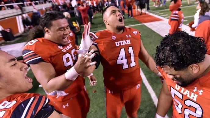 SALT LAKE CITY, UT - NOVEMBER 24: Hauati Pututau #41 celebrates with Leki Fotu #99 of the Utah Utes and others their 35-27 win over the Brigham Young Cougars in a game at Rice-Eccles Stadium on November 24, 2018 in Salt Lake City, Utah. (Photo by Gene Sweeney Jr/Getty Images)