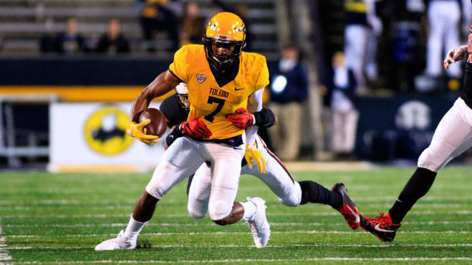 TOLEDO, OH - OCTOBER 31: Jon'vea Johnson #7 of the Toledo Rockets runs the ball in the game against the Ball State Cardinals on October 31, 2018 in Toledo, Ohio. (Photo by Justin Casterline/Getty Images)
