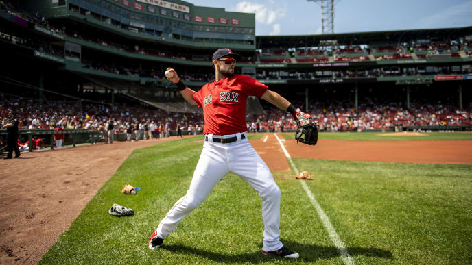 BOSTON, MA - AUGUST 18: Chris Owings #36 of the Boston Red Sox warms up before a game against the Baltimore Orioles on August 18, 2019 at Fenway Park in Boston, Massachusetts. (Photo by Billie Weiss/Boston Red Sox/Getty Images)