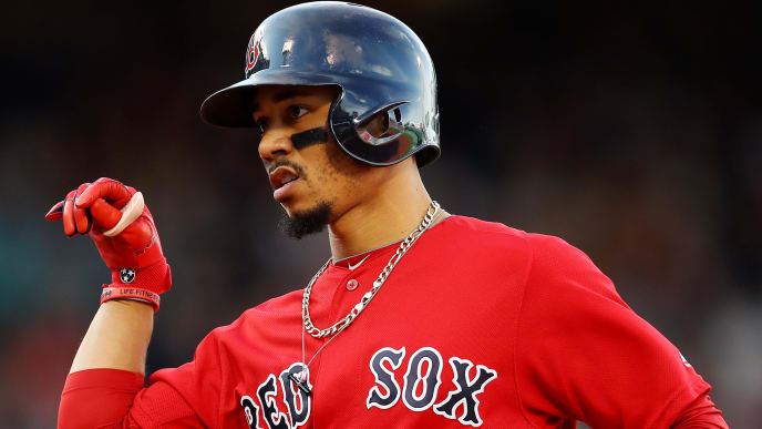 BOSTON, MASSACHUSETTS - SEPTEMBER 29: Mookie Betts #50 of the Boston Red Sox celebrates after hitting a single during the third inning against the Baltimore Orioles at Fenway Park on September 29, 2019 in Boston, Massachusetts. (Photo by Maddie Meyer/Getty Images)