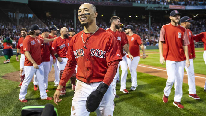 BOSTON, MA - SEPTEMBER 29: Mookie Betts #50 of the Boston Red Sox reacts after scoring the game winning run on a walk-off single hit by Rafael Devers #11 during the ninth inning of a game against the Baltimore Orioles on September 29, 2019 at Fenway Park in Boston, Massachusetts. (Photo by Billie Weiss/Boston Red Sox/Getty Images)