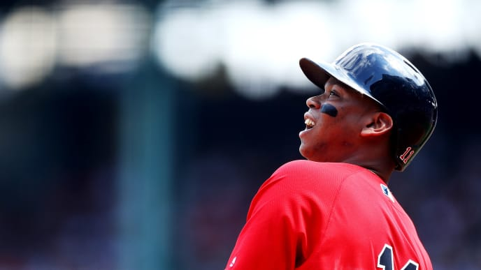 BOSTON, MASSACHUSETTS - AUGUST 18: Rafael Devers #11 of the Boston Red Sox watches his foul ball during the first inning against the Baltimore Orioles at Fenway Park on August 18, 2019 in Boston, Massachusetts. (Photo by Maddie Meyer/Getty Images)