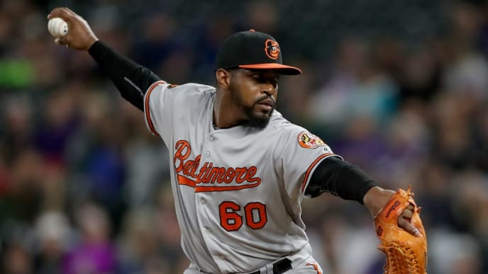 DENVER, COLORADO - MAY 24: Pitcher Mychal Givens #60 of the Baltimore Orioles throws in the sixth inning against the Colorado Rockies at Coors Field on May 24, 2019 in Denver, Colorado. (Photo by Matthew Stockman/Getty Images)