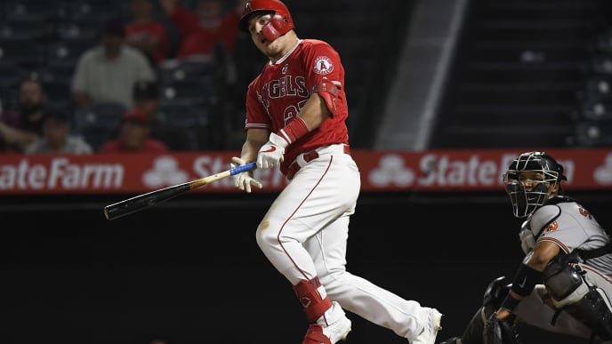 ANAHEIM, CA - JULY 25:  Mike Trout #27 of the Los Angeles Angels of Anaheim hits two-run double tote up the game against Baltimore Orioles during the 15th inning at Angel Stadium of Anaheim on July 25, 2019 in Anaheim, California. (Photo by Kevork Djansezian/Getty Images)