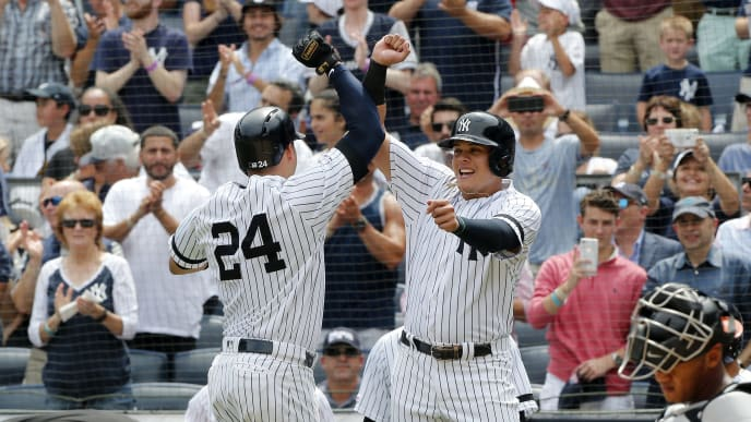 NEW YORK, NEW YORK - AUGUST 14:   Gary Sanchez #24 of the New York Yankees celebrates his first inning three run home run against the Baltimore Orioles with teammate Gio Urshela #29 at Yankee Stadium on August 14, 2019 in New York City. (Photo by Jim McIsaac/Getty Images)