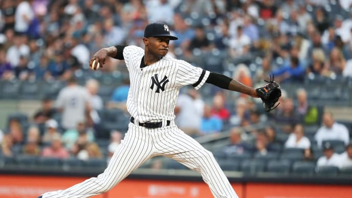 NEW YORK, NEW YORK - AUGUST 11:  Domingo German #55 of the New York Yankees pitches against the Baltimore Orioles during their game at Yankee Stadium on August 11, 2019 in New York City. (Photo by Al Bello/Getty Images)