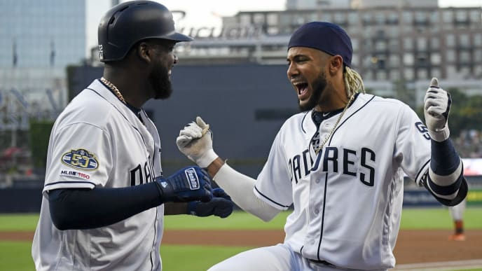 SAN DIEGO, CA - JULY 29: Franmil Reyes #32 of the San Diego Padres, left, is congratulated by Fernando Tatis Jr. #23 after hitting a solo home run during the first inning of a baseball game against the Baltimore Orioles at Petco Park July 29, 2019 in San Diego, California.  (Photo by Denis Poroy/Getty Images)