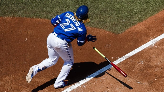 TORONTO, ONTARIO - JULY 7: Vladimir Guerrero Jr. #27 of the Toronto Blue Jays hits a double against the Baltimore Orioles in the fourth inning during their MLB game at the Rogers Centre on July 7, 2019 in Toronto, Canada. (Photo by Mark Blinch/Getty Images)
